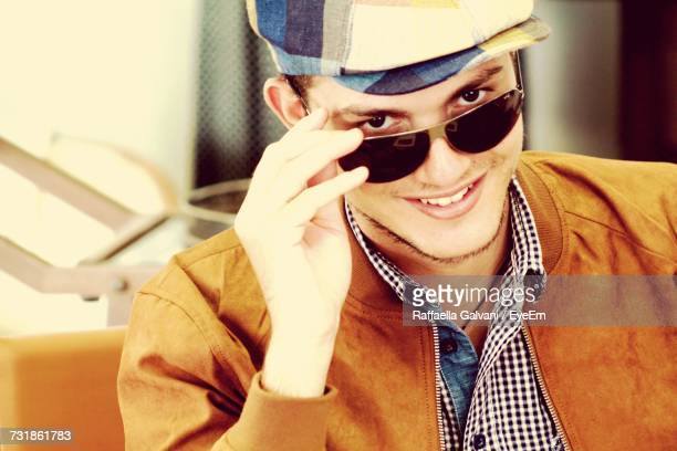 Portrait Of Smiling Young Man With Sunglasses