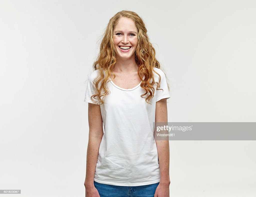 Portrait of smiling young woman with long blond hair