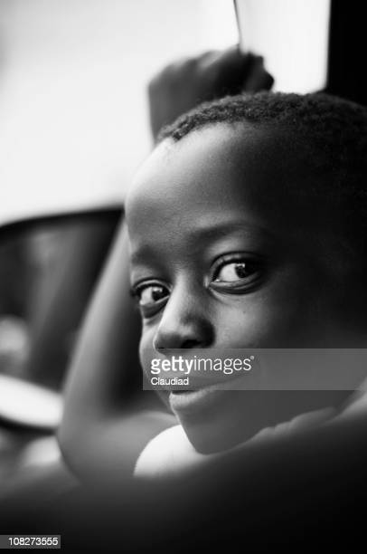 Portrait of Smilling Little Boy in Car, Black and White