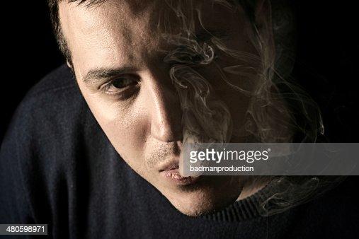 Portrait of smoking man : Stock Photo
