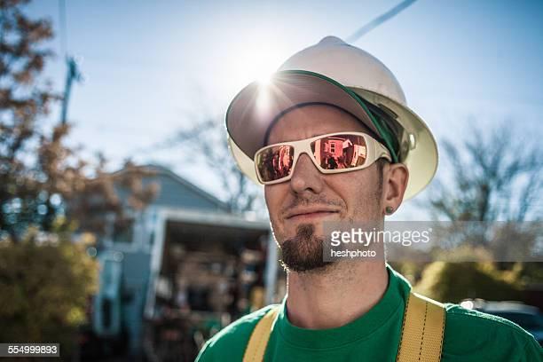 Portrait of solar panel installation crew member