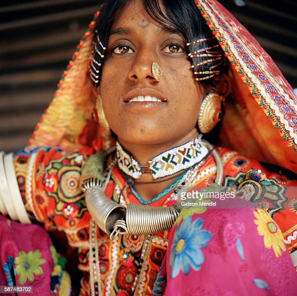 A portrait of Sonabai Megha Harijan displaying some of the beautiful Megwhal craft that is part of her daily attire She lives in Harijan Vaasone of...