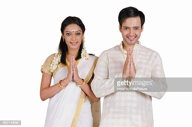 Portrait of South Indian couple greeting