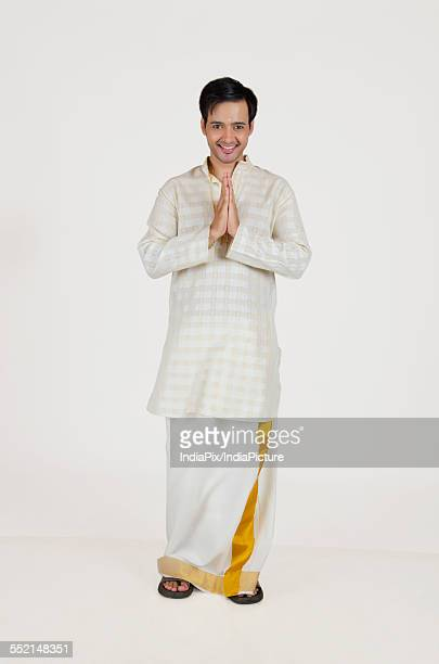 Portrait of South Indian man greeting