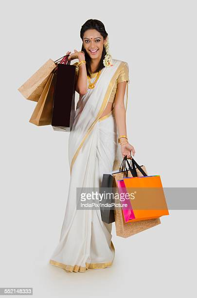 Portrait of South Indian woman with shopping bags