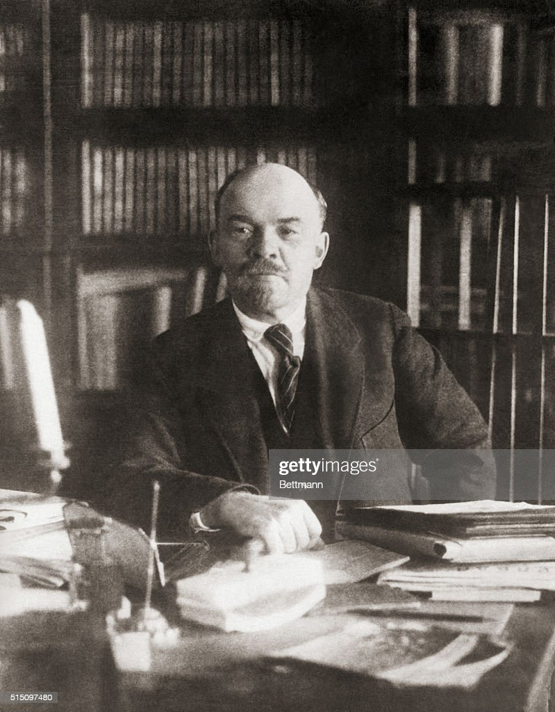 Portrait of Soviet leader Vladimir Ilich Lenin (1870-1924) sitting alone at a desk. Undated photo, filed 1931.