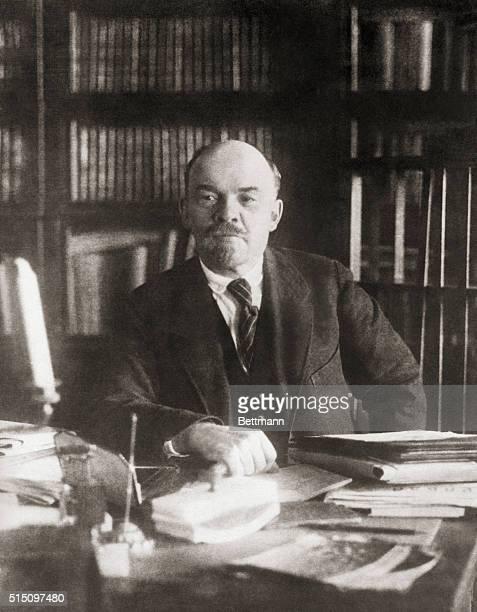Portrait of Soviet leader Vladimir Ilich Lenin sitting alone at a desk Undated photo filed 1931