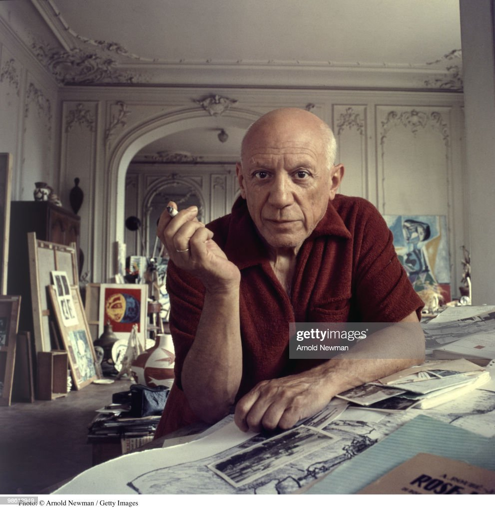 Portrait of Spanish artist <a gi-track='captionPersonalityLinkClicked' href=/galleries/search?phrase=Pablo+Picasso&family=editorial&specificpeople=85469 ng-click='$event.stopPropagation()'>Pablo Picasso</a> (1881 - 1973) as he smokes a cigarette, Cannes, France, September 11, 1956.