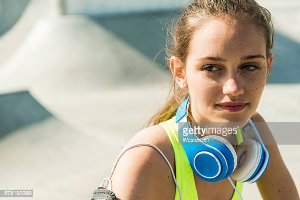 Portrait of sportive young woman with blue headphones