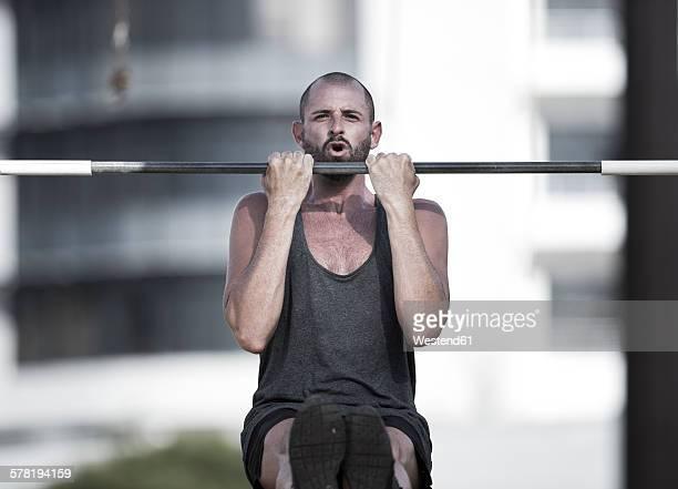 Portrait of sportsman doing chin-ups