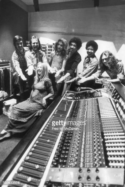 Portrait of standing from left American studio manager Jim Marron South Africanborn American music producer and engineer Eddie Kramer English...