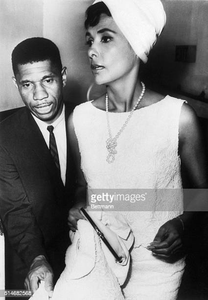 A portrait of State Field Representative Medgar Evers escorting singer Lena Horne to a civil right rally in Jackson Mississippi