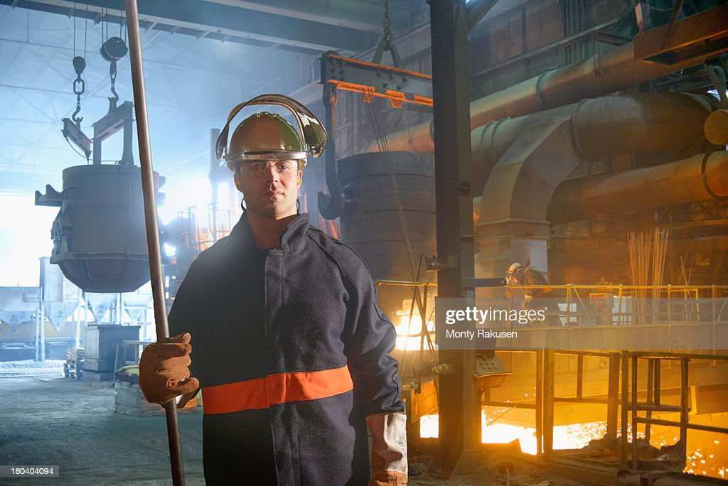 Portrait of steel worker in protective clothing in steel foundry