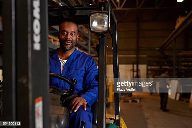 Portrait of steel worker sitting on forklift