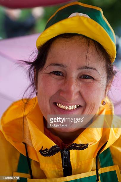 Portrait of street vendor with golden teeth.