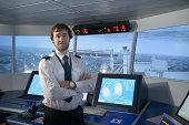 Portrait of student in ship's bridge simulation room