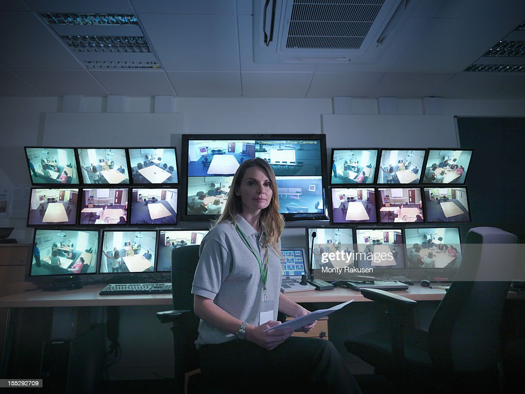 Portrait of student with screens in forensics training facility