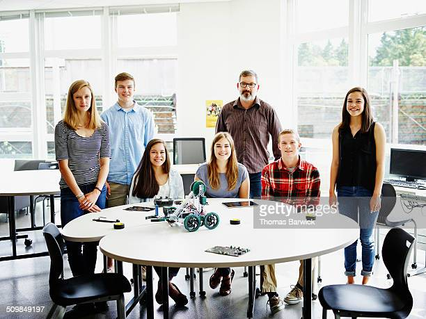 Portrait of students and teacher in robotics class