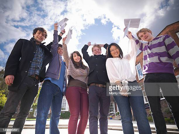 Portrait of students celebrating  exam results