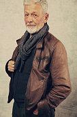 Portrait of stylish elderly bearded man wearing leather jacket. Fashion , lifestyle concept, vintage image