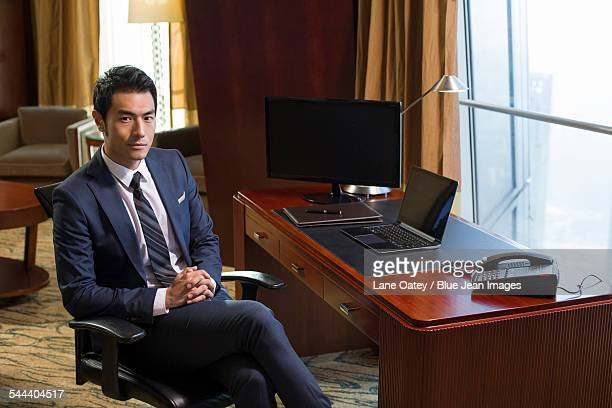 Portrait of successful businessman in study