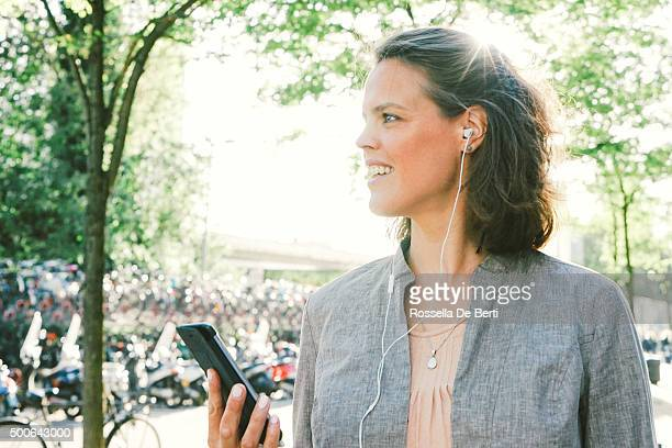 Portrait Of Successful Businesswoman Using Smartphone In Urban Landscape