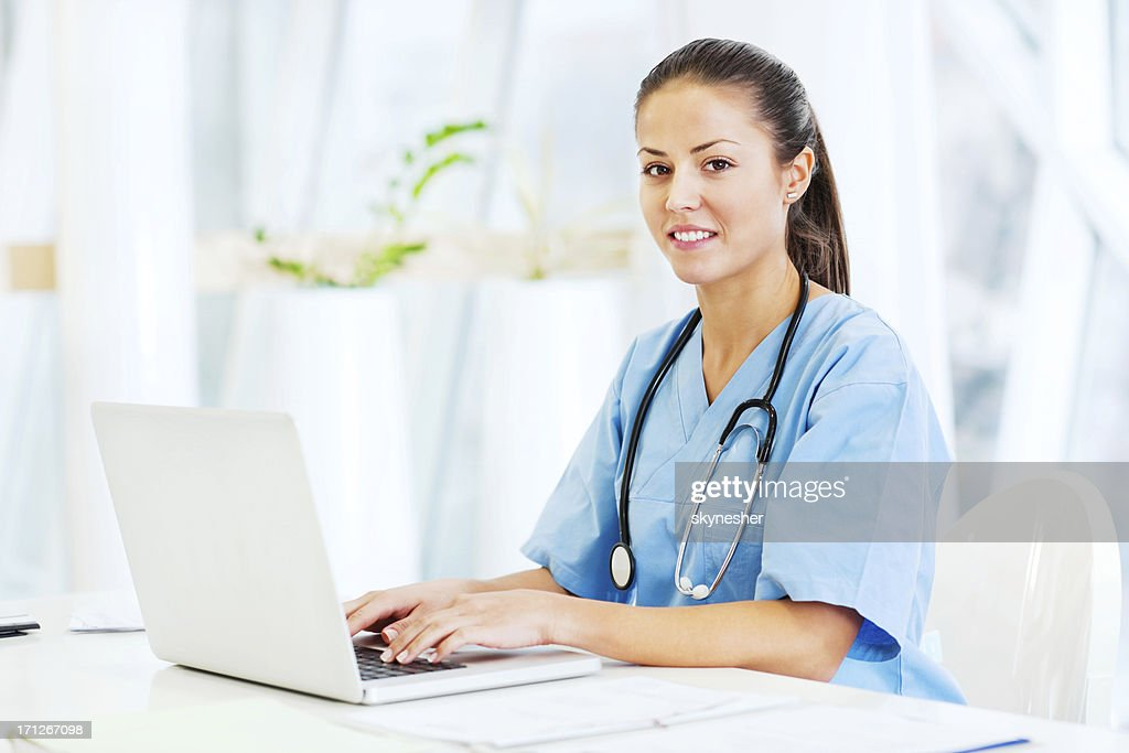 Portrait of successful doctor working on a laptop. : Stock Photo