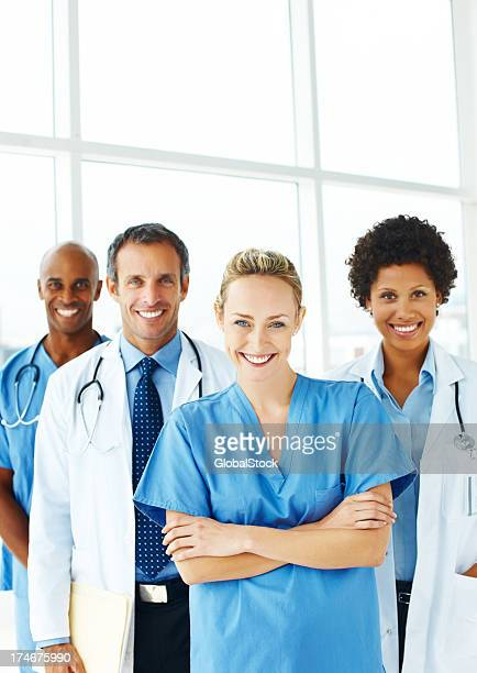 Portrait of successful doctors standing together and smiling