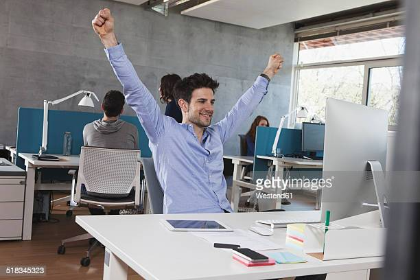 Portrait of successful man at his workplace in the office