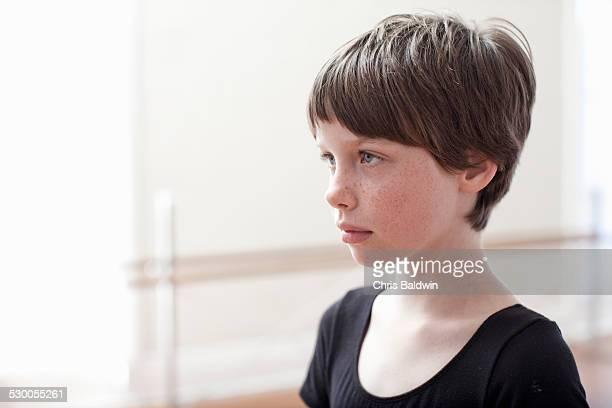 Portrait of sullen girl in ballet school