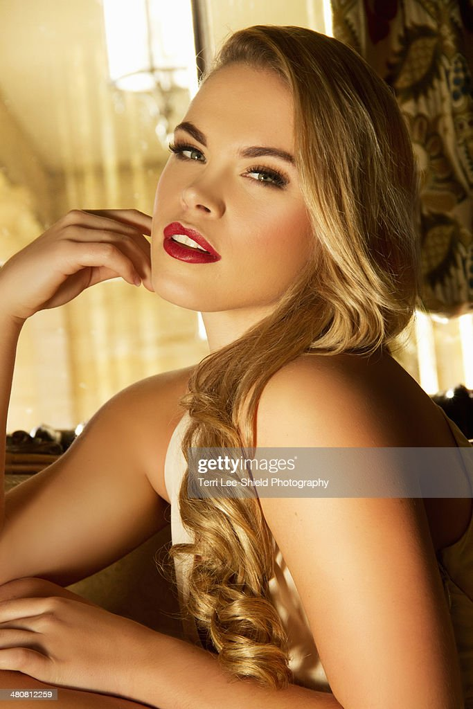 Portrait of sultry young woman on sofa