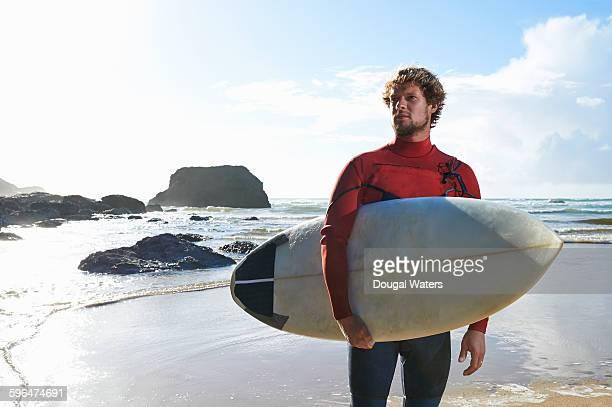 Portrait of surfer on Atlantic coastline.