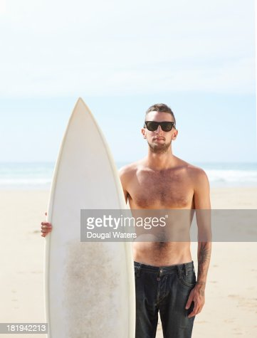 Portrait of surfer with board. : Stock Photo