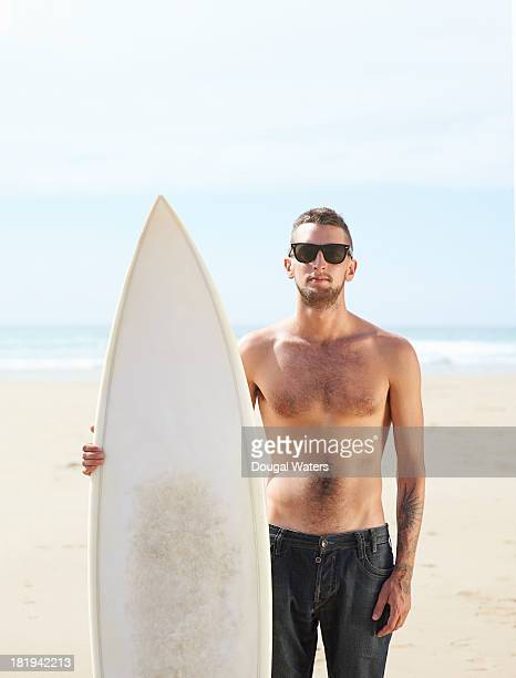 Portrait of surfer with board.