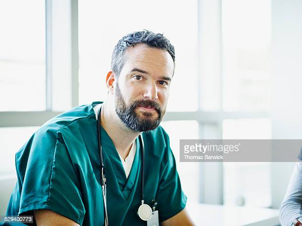 Portrait of surgeon wearing scrubs in hospital