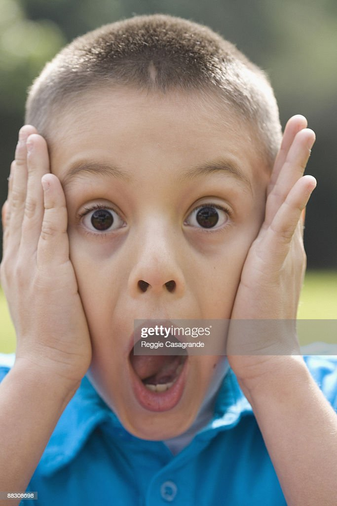 Portrait of surprised boy : Stock Photo