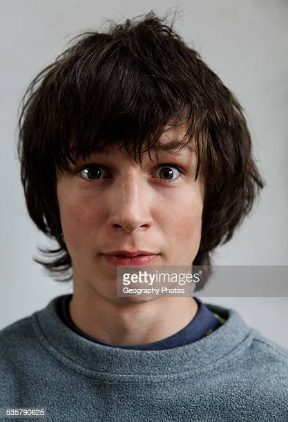portrait of surprised expression of teenage boy's face