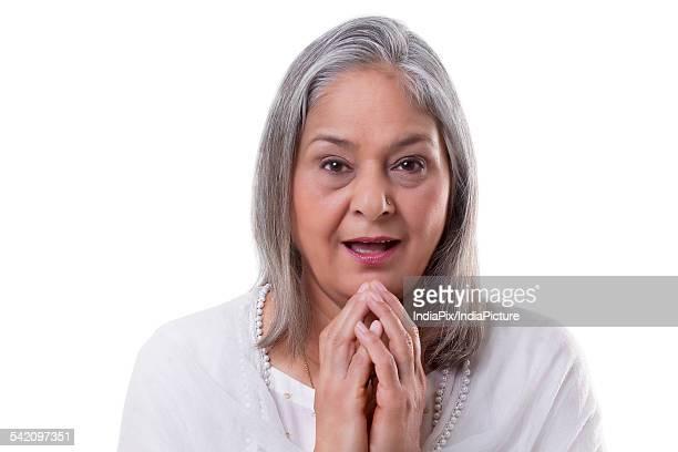 Portrait of surprised mature woman