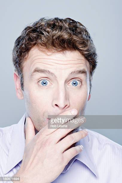 Portrait of surprised mid adult man, studio shot