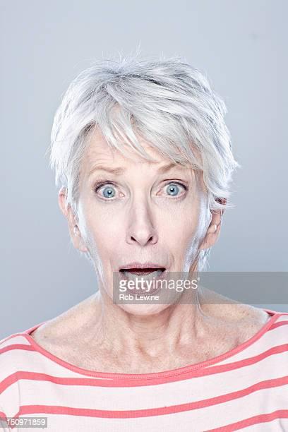 Portrait of surprised senior woman, studio shot