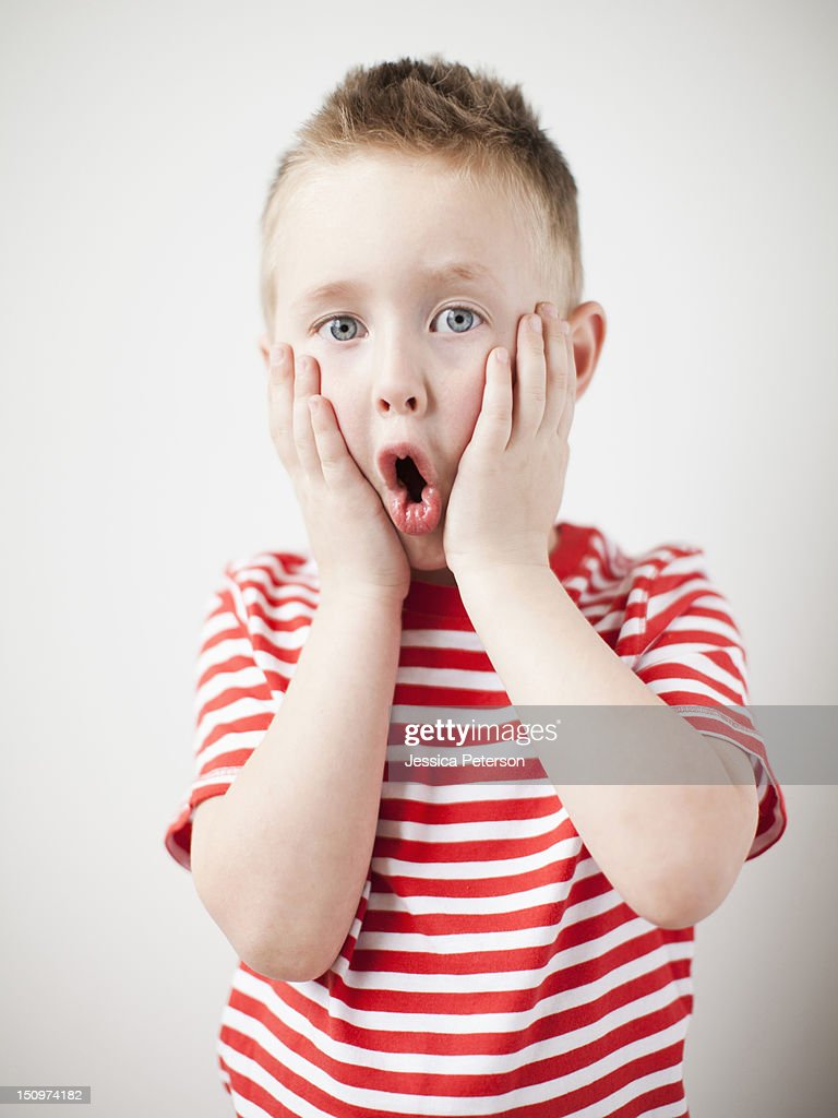 Portrait of surprised toddler boy (2-3) : Stock Photo