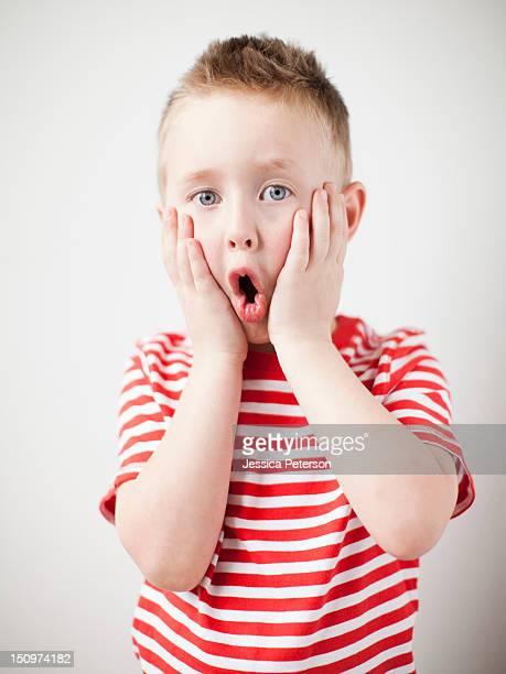 Portrait of surprised toddler boy (2-3)