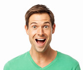 Portrait of surprised young man with mouth open over white background. Horizontal shot.