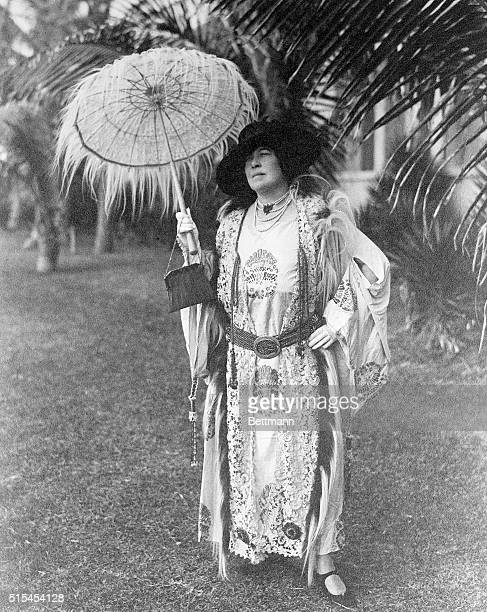 Portrait of survivor of the sinking ship The Titanic Mrs JJ Molly Brown She is standing regally holding a parasol