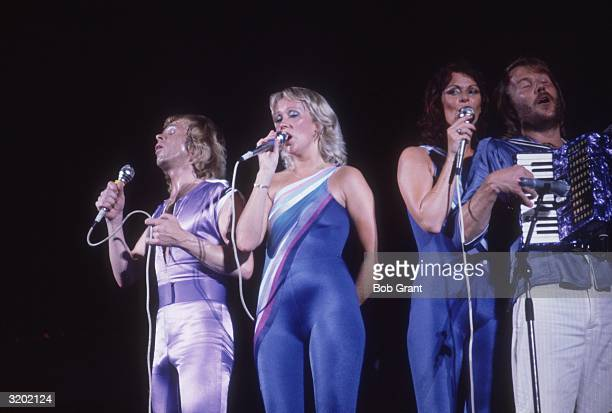 A portrait of Swedish pop group ABBA performing in spandex costumes