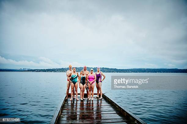 Portrait of swimmers on dock before morning swim