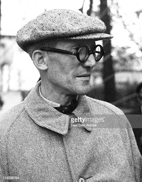 Portrait of Swissborn French architect Le Corbusier as he stands outdoors 1937