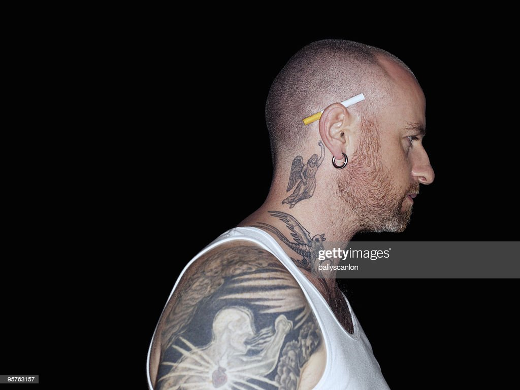 Portrait of Tattooed Man With Cigarette in Ear. : Stock Photo