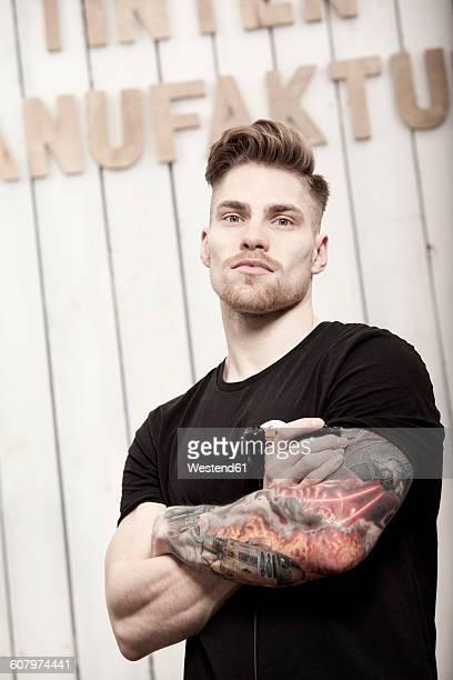 Portrait of tattooist in his tattoo studio