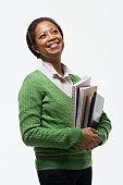 Portrait of teacher holding books